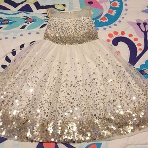A gold and silver sequin dress